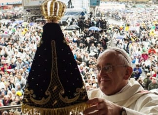 Pope Francis with Our Lady of Aparecida in Brazil in 2013 | Vatican News